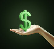 3d Green Dollar Sign on a  hand. 3d Green Dollar Sign on a hand.On a black background Royalty Free Stock Image