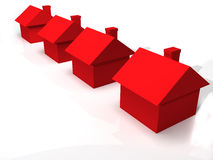 3D group of houses. A 3D rendered image of red houses isolated on a white reflective background Royalty Free Stock Photo