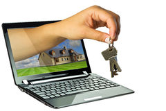 3D hand giving virtual keys to new house. Black netbook with 3D hand giving keys to new house Royalty Free Stock Image