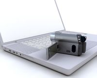 3D handy cam over a laptop Royalty Free Stock Images