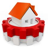 3d house symbol in a gear wheel Royalty Free Stock Photos