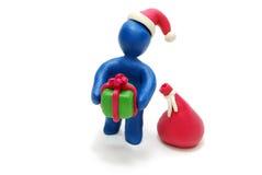3D Kerstman die Gift geeft Stock Foto