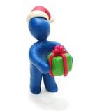 3D Kerstman die Gift geven Stock Fotografie