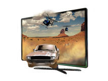 3D Led slim Television. From which screen seems to come out a white car in the desert of Monument Valley Royalty Free Stock Image