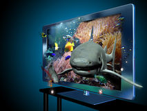 3D led  television. A 3D led television with images of a documentary with fishes and sharks under the sea, that give the impression to  come out from the screen Royalty Free Stock Photos
