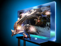 3D led television. A 3D led television with an image of  a spaceship battle   coming out of the screen Stock Images