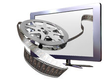 3D led television. A 3D led television from which a film roll seem to come out Royalty Free Stock Photography