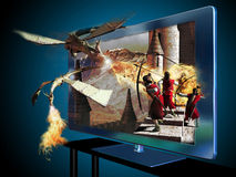 3D led television. A 3D Led television with an image of a movie about dragons and medieval soldiers Royalty Free Stock Photography