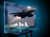 3D led television. A fighter flying over the ocean, seems to come out from the screen in a 3D movie Stock Photography