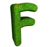 3d letter F in green grass Royalty Free Stock Photo