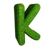 3d letter K in green grass Stock Photo
