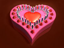 3d lit candle on red heart cake Stock Photo