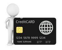 3D little human holding a Credit Card. Isolated Royalty Free Stock Image