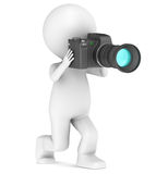 3d little human taking a photo. 3d little human character with a camera Stock Images