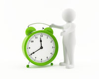 3D man with an alarm clock. 3D man with a giant green alarm clock Stock Photography