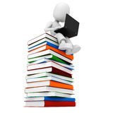 3d man, books and a laptop Stock Photo