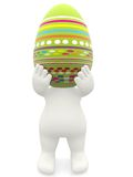 3D man carrying an easter egg Stock Images