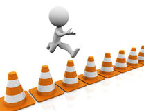 3d man challenge jump. 3d man jumping over traffic cones Royalty Free Stock Images