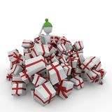 3d man with christmas gift boxes. Isolated on white Royalty Free Stock Photo