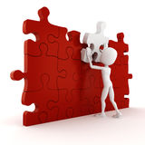 3d man completing a puzzle. On white background Royalty Free Stock Photography