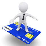3D man with credit card. 3D man syrfing on a bank credit card Stock Photography