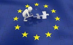 3d man finalizing European Union flag puzzle. 3d man finalizing the European Union flag puzzle with the final piece Stock Photo