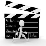 3d man in front of a movie clipper. 3d man running in front of a big movie clipper Stock Images