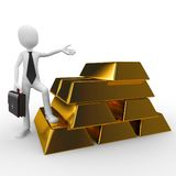 3d man with gold bricks Stock Photos