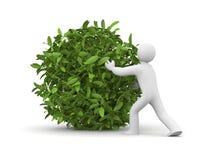 3d man with green grass ball Royalty Free Stock Photos