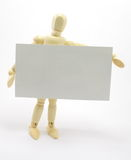 3D Man Holding Blank Business Card. Wooden man.  Card ready for your message or logo Royalty Free Stock Images