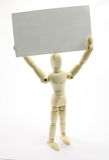 3D Man Holding Blank Business Card above head. Wooden man.  Card ready for your message or logo Stock Images