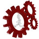3d man inside a gear wheel Stock Photos