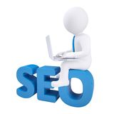 3d man with laptop sitting on SEO Stock Photo