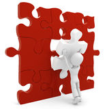 3d man pushing a puzzle piece Royalty Free Stock Photo
