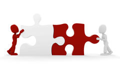 3d man pushing a puzzle piece. Into its place Stock Image