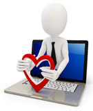 3d man with red heart and laptop. On white background Stock Photos