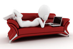 3d man in a red sofa, working at hes laptop Royalty Free Stock Image