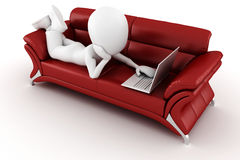 3d man in a red sofa, working at hes laptop Royalty Free Stock Images