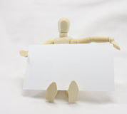 3D Man Sitting with Blank Business Card Stock Photo
