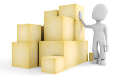 3d man and some boxes Royalty Free Stock Image