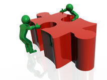 3D mans and puzzles. Red and green Stock Images