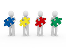 3d men puzzle teamwork. Red blue green yellow Royalty Free Stock Images