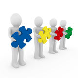 3d men puzzle teamwork. Red blue green yellow Royalty Free Stock Image