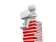 3d mensenzitting op een stapel van boeken die bij zijn lapop werken. Stock Foto's