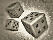 3D modeled dice. Monochrome illustration of three dice with selective focus on the largest, nearest and brightest one and with a grunge background Royalty Free Stock Photos