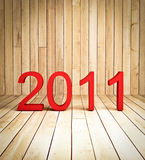 3d new year 2011 on wood background. Texture perspective view Stock Image