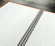 3d open blank notebook on desk paper texture Stock Photo