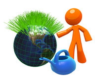 3d orange man with watering can and globe. 3d Orange Man ready to service the globe, with watering can. Green earth environmental concept Royalty Free Stock Photo