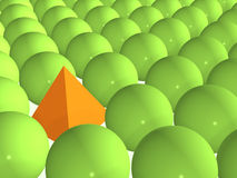 3d orange pyramid among green spheres Stock Photos