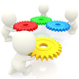 3D people assembling cogwheels Royalty Free Stock Photos